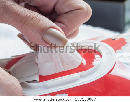 Wet wipes in a woman's hand. #597158009