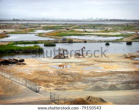 wetland with many oil derricks