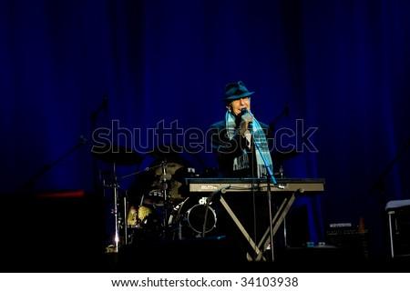 WEYBRIDGE, UK - JULY 11: Singer/songwriter Leonard Cohen performs at his concert in Mercedes Benz World, July 11, 2009 in Weybridge, London, UK. - stock photo