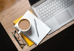 WFH - Work from Home Flatlay Photo of Desk with Laptop, Notepad, Glasses and Cup of Tea