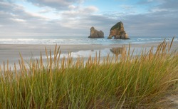 Wharariki Beach, Golden Bay, New Zealand. The rock formation at Wharariki Beach is one of the most photographed of New Zealand's South Island's landscapes.