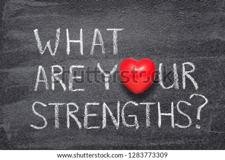 what are your strengths question handwritten on chalkboard with red heart symbol instead of O