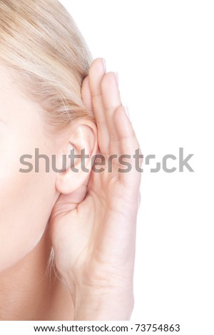 What? Closeup for female hand on ear. Listening. Vertical
