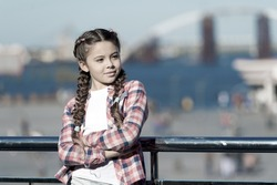 What do on holidays. Sunny day walk. Leisure options. Free time and leisure. Girl cute kid with braids relaxing urban background defocused. Organize activities for teenagers. Vacation and leisure