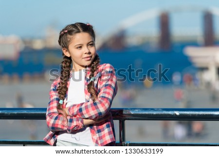 What do on holidays. Sunny day walk. Leisure options. Free time and leisure. Girl cute kid with braids relaxing urban background defocused. Organize activities for teenagers. Vacation and leisure.
