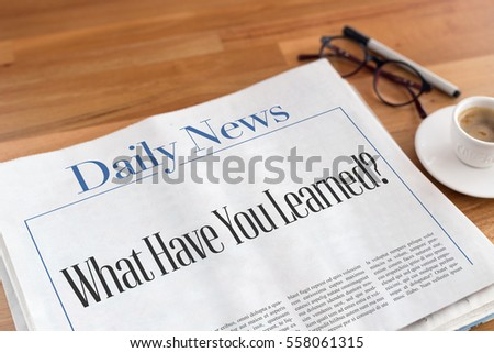 What Have You Learned? headlined newspaper on the table #558061315