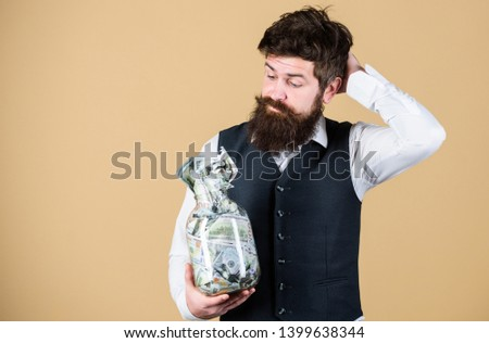 What is a good way of investing money. Bearded man thinking of investing money into business. Businessman calculating his future cash flow from investing activities. Investing in future, copy space.