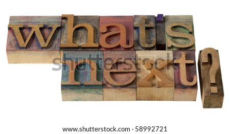 what is next question in vintage wooden letterpress printing blocks, stained by color inks - stock photo