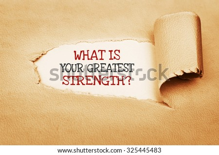 What is Your Greatest Strength? text written behind a torn paper