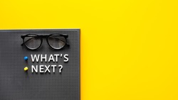 What's next ? text with glasses on work table.trends research and new things.business startup concepts