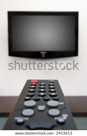 What's on? ( shallow DOF, focus on far end of remote control) - stock photo