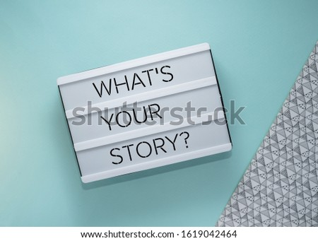 What's your story? Text on lightbox on blue background