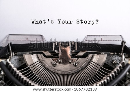 what\'s your story? The text is typed on paper with an old typewriter, a vintage inscription, a story of life.