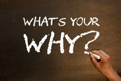 What's Your Why question handwriting with chalk on blackboard. Business concept.