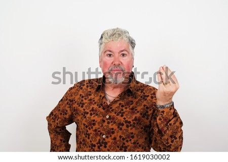 What the hell are you talking about. Shot of frustrated European man gesturing with raised hand doing Italian gesture, frowning, being displeased and confused with dumb question.
