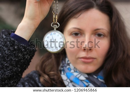 What time is it. Autumn background. A girl with a clock, beautiful girl, woman and time, acquaintance, how to meet, date, flirt, woman with a clock, time, catch up, keep track of time, time limited.