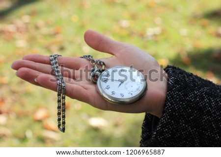 What time is it. Autumn background. A girl with a clock, beautiful girl, woman and time, acquaintance, how to meet, date, flirt, woman with a clock, catch up, keep track of time, time limited.