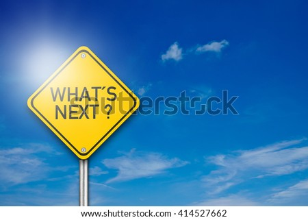 Whats Next Sign on blue background