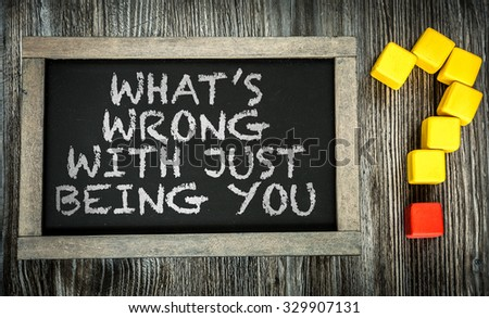 Whats Wrong With Just Being You? written on chalkboard #329907131
