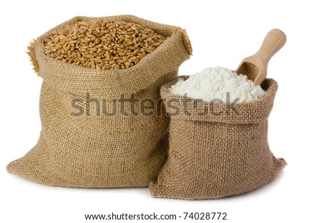 Wheat and flour in small burlap sacks