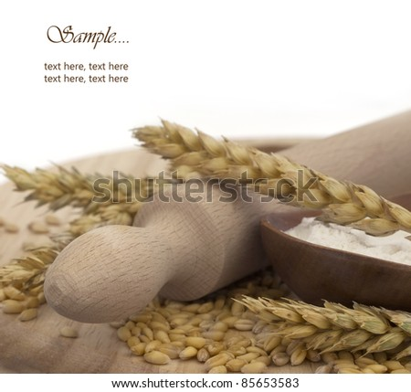 wheat and flour with place for the text - stock photo