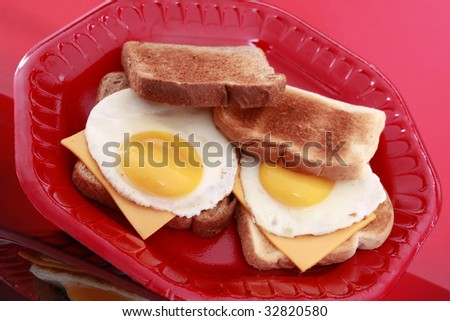 Wheat and white egg and cheese sandwich