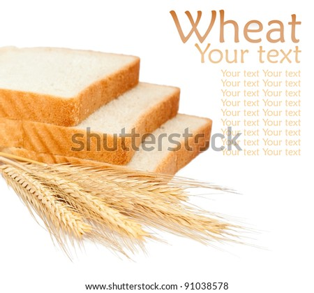Wheat bread and grains and ears on white background