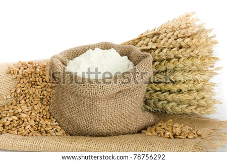 Wheat ears and flour in burlap bag