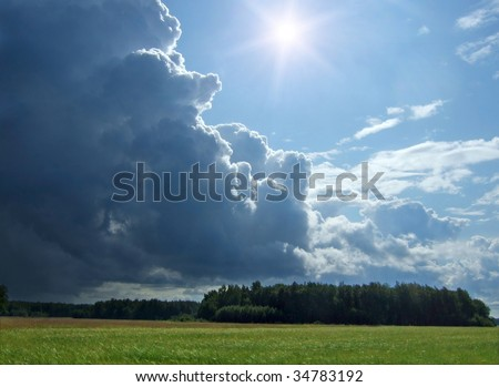 wheat field and rainy clouds