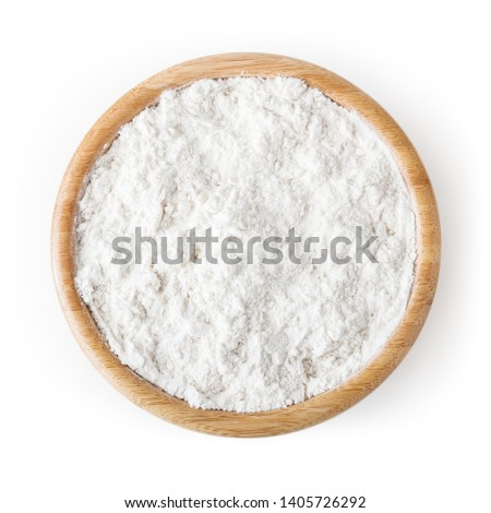 Wheat flour in wooden bowl isolated on white background with clipping path #1405726292