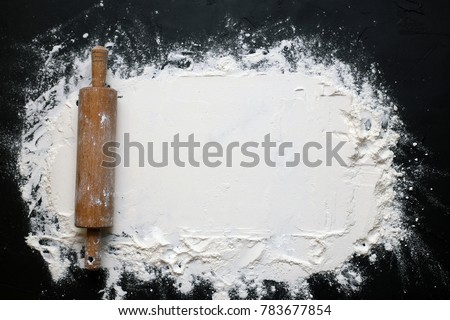 Wheat flour rolled out on a black background for text #783677854