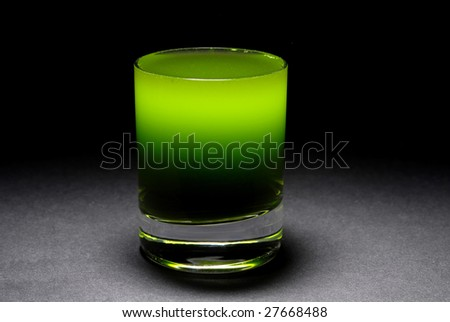 Wheat grass in a shot glass - stock photo