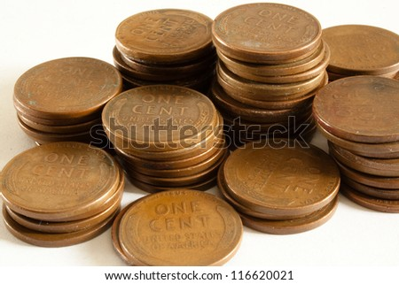 Wheat Pennies in Stacks. Stacks of old American one cent wheat pennies.