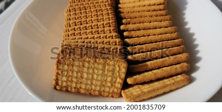 Wheat tea biscuits  arranged on white plate. Indian chai biscuit Photo stock ©