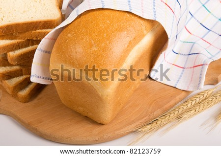 Wheaten bread on the board still-life