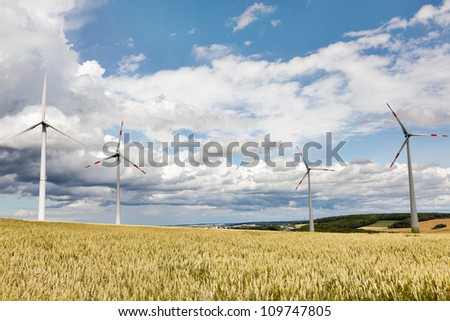 Wheatfield with windmills