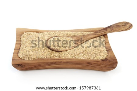 Wheatgerm health food in an olive wood bowl with spoon. Stock photo ©