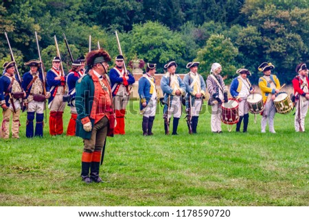 WHEATON, IL/USA - SEPT. 8, 2018: Continental forces await orders during morning review before a tactical demonstration at a reenactment of the American Revolutionary War (1775-1783) in Cantigny Park. - Shutterstock ID 1178590720