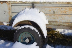 Wheel and a rusted body of the trailer