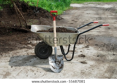 wheel barrow on the land at the county with land and shovel