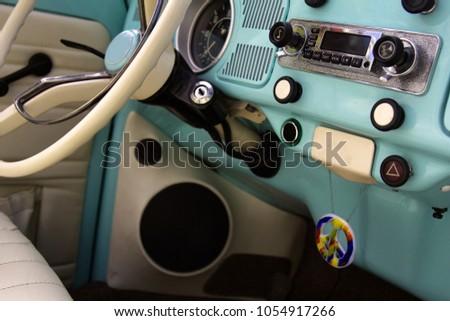 wheel car of mid-20th century. Interior of old car (car salon) with radio and control keys. Soviet government car GAZ-13 Chaika, Executive passenger vehicle
