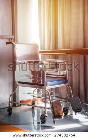 Wheel chair in hospital. Vintage filter.
