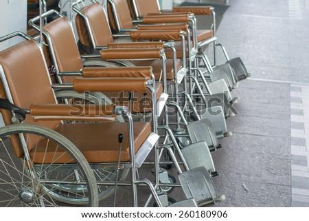 Wheel chair in the hospital corridor.