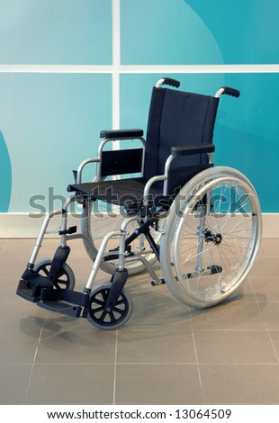 wheel chair over green background