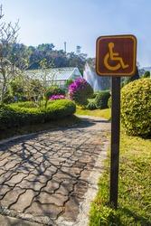 wheel chair sign in garden