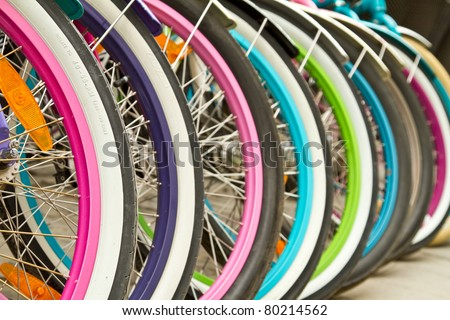 Wheel detail of a group of bikes - stock photo