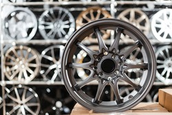 Wheel disks closeup, sale of disks in the showroom. Chrome wheels modern exclusive design.