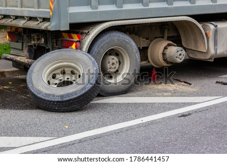 Wheel hub and truck tire in process of changing wheel nut. Maintenance a truck wheels hub and bearing. Rear wheels hub and bolt nut of a truck in process of changing wheel. Brake disc under