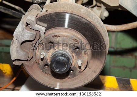 Wheel hub motor car in a repair situation stock photo for Motor vehicle repair license