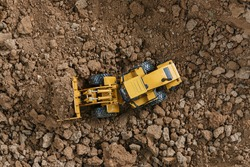 Wheel loader are digging the soil in the construction site ,Top view